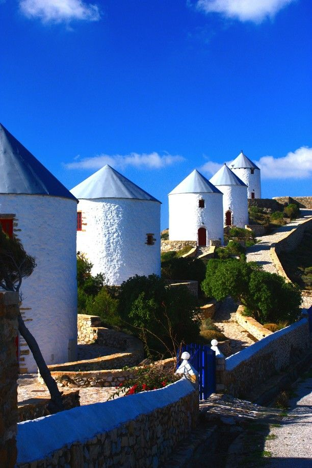 Panteli, Kalimnos, Greece — by Vagrants Of The World. The windmills of Leros. Old mills line the ridge overlooking Panteli. They sit in the shadow of Leros Castle like...