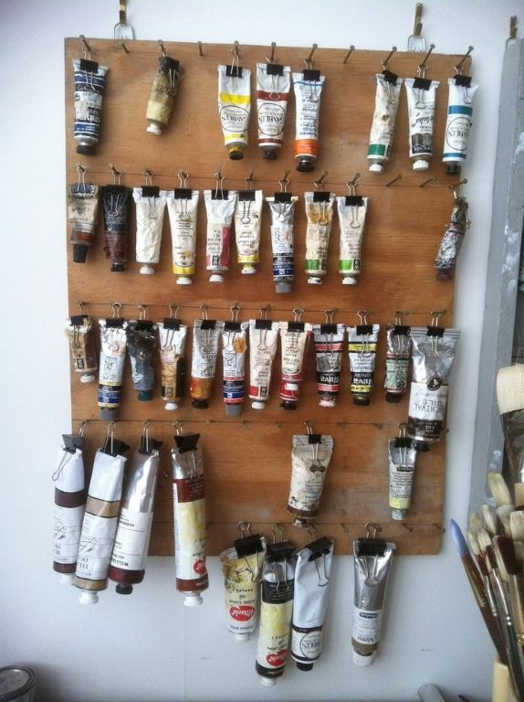 Clever paint storage. - Great for all the oil paints in their tubes instead of just thrown in drawers or bins. Much easier to see the colors and keep them from making a mess accidentally (well at least reduces the risk)