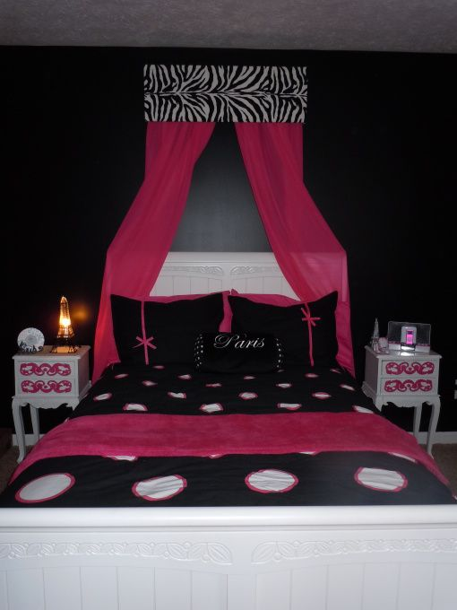 My daughters redecoratede bedroom, I painted all of my daughters wicker  furniture black and all