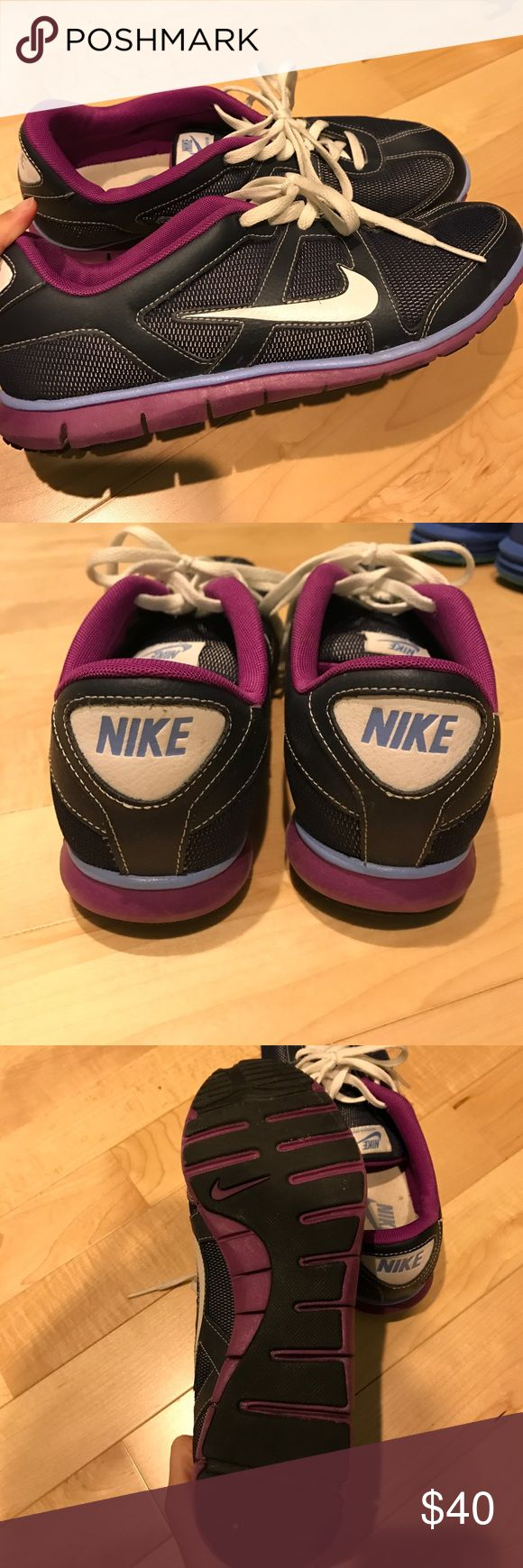 Nike Casual Athletic Shoes Worn less than 5 times! Navy with light blue and purple accents. White laces. Great for bumming around or walking to and from class or work. Nike Shoes Athletic Shoes