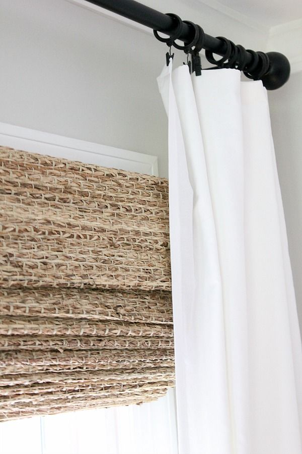 Just a little window dressing - This blogger transformed her windows with homemade curtains and woven shades from The Shade Store