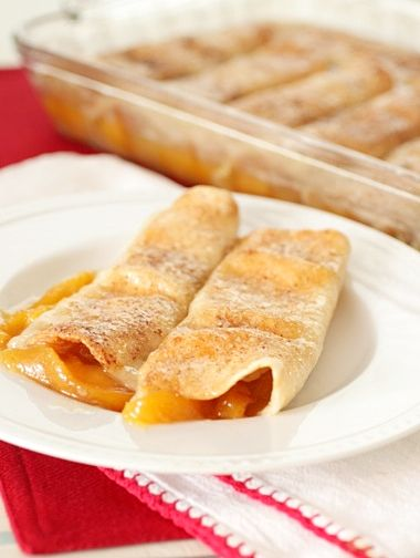 Peach Cobbler Enchiladas  4 cups peaches, peeled and sliced  1 cup sugar  squirt fresh lemon juice  2 sticks unsalted butter*  1 cup sugar  pinch salt  10-12 flour tortillas  cinnamon and sugar, for sprinkling