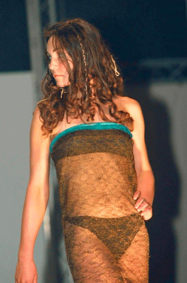 Atlhough the two had been platonic friends, Kate Middleton first grabbed Prince William's romantic attention when she modelled lingerie in a school fashion show at the University of St. Andrews in 2002.