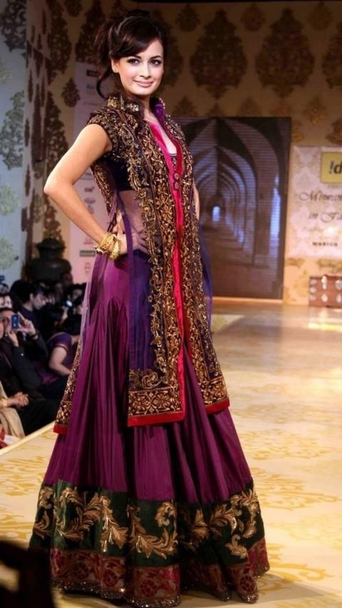 STUNNING!! #diyamirza in gorgeous purple and red #lengha