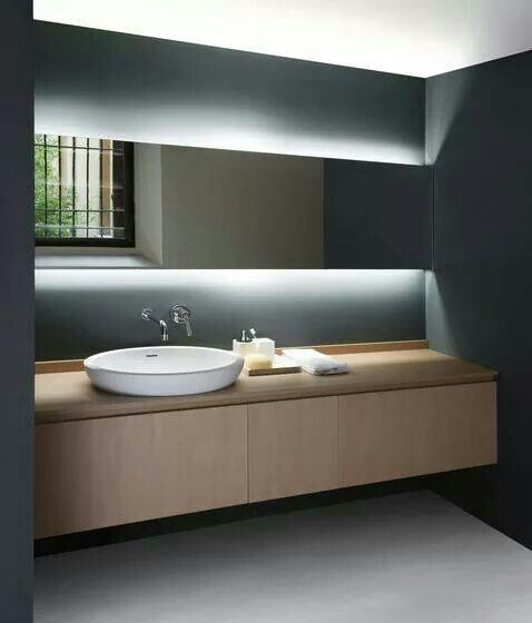 Love the slate walls with the light and mirror