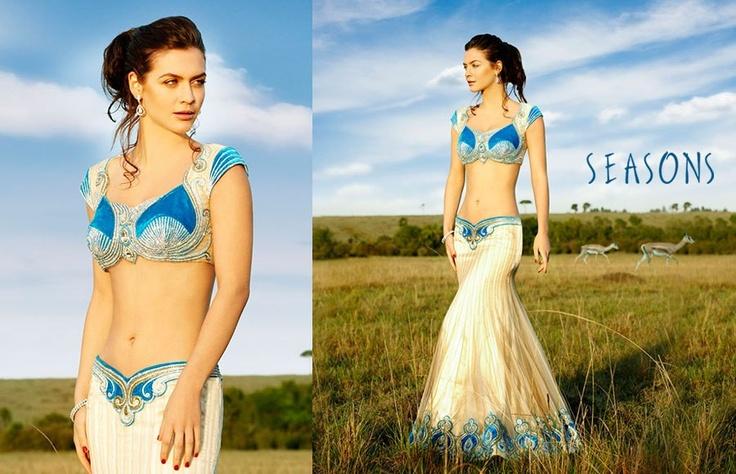 Blue & white. It's so beautiful I love there collection ♥  Hindu / indian bride Wear saree, lehenga, choli from seasonsindia. the model is Neha Dalvi or maria sokolovski