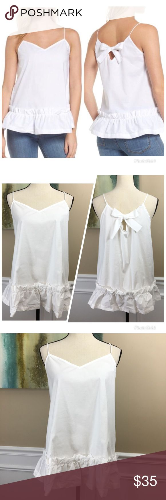 """PLEIONE Bow Back Tank Top XL NEW PLEIONE Bow Back Tank Top (C23) New With Tags White A camisole-style poplin tank exudes girly charm with a sweet bow at the V-back and a ruffle around the hem, - Slips on over head- Spaghetti-strap V-neck- Sleeveless- 97% cotton, 3% spandex Women's SZ XLarge Measurements Laying Flat Under Arm to Under Arm 20.6"""" Adjustable Length 28.6"""" Pleione Tops Tank Tops"""