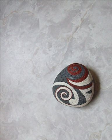 Koru hand-painted rocks.