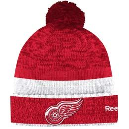 Official Detroit Red Wings cuffed pom knit toque from Reebok. Made of 100% Acrylic material knit in team colors featuring a raised embroidered team crest logo on the front of the toque.