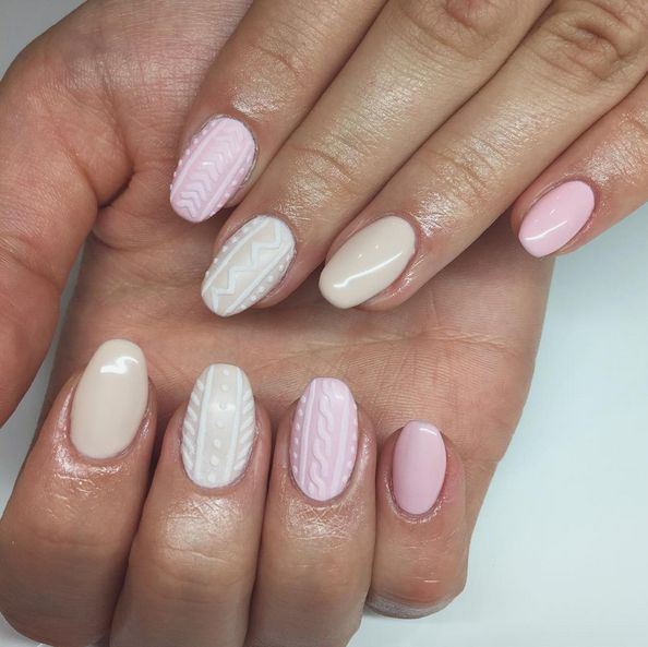 And this year, women are taking it to another level: Sweater nails. | Women Are Painting Tiny 3-D Sweaters On Their Nails For Winter
