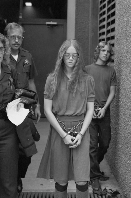 """16-year-old Brenda Ann Spencer being taken to prison after killing two people. Her answer as to why she did it was """"I don't like Mondays."""", 1979"""