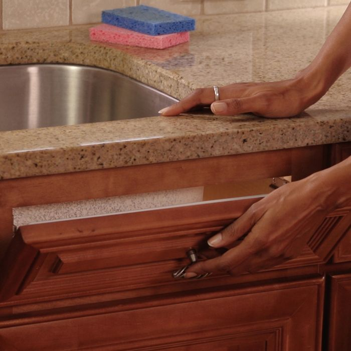 How-to: Turn your kitchen sink's false drawer into a functional storage space.