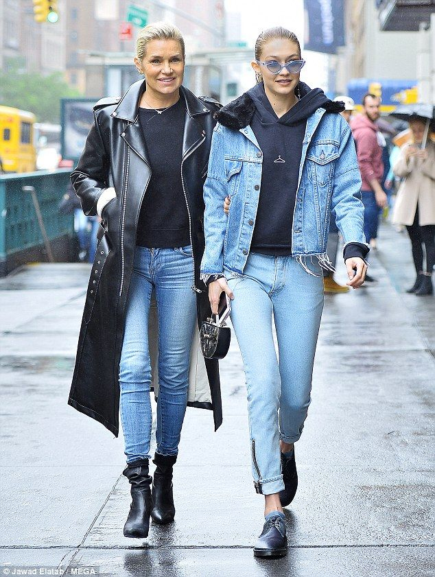Double denim: Gigi Hadid (right) and mum Yolanda (left) wore matching denim looks for a girls' day out in NYC on Thursday