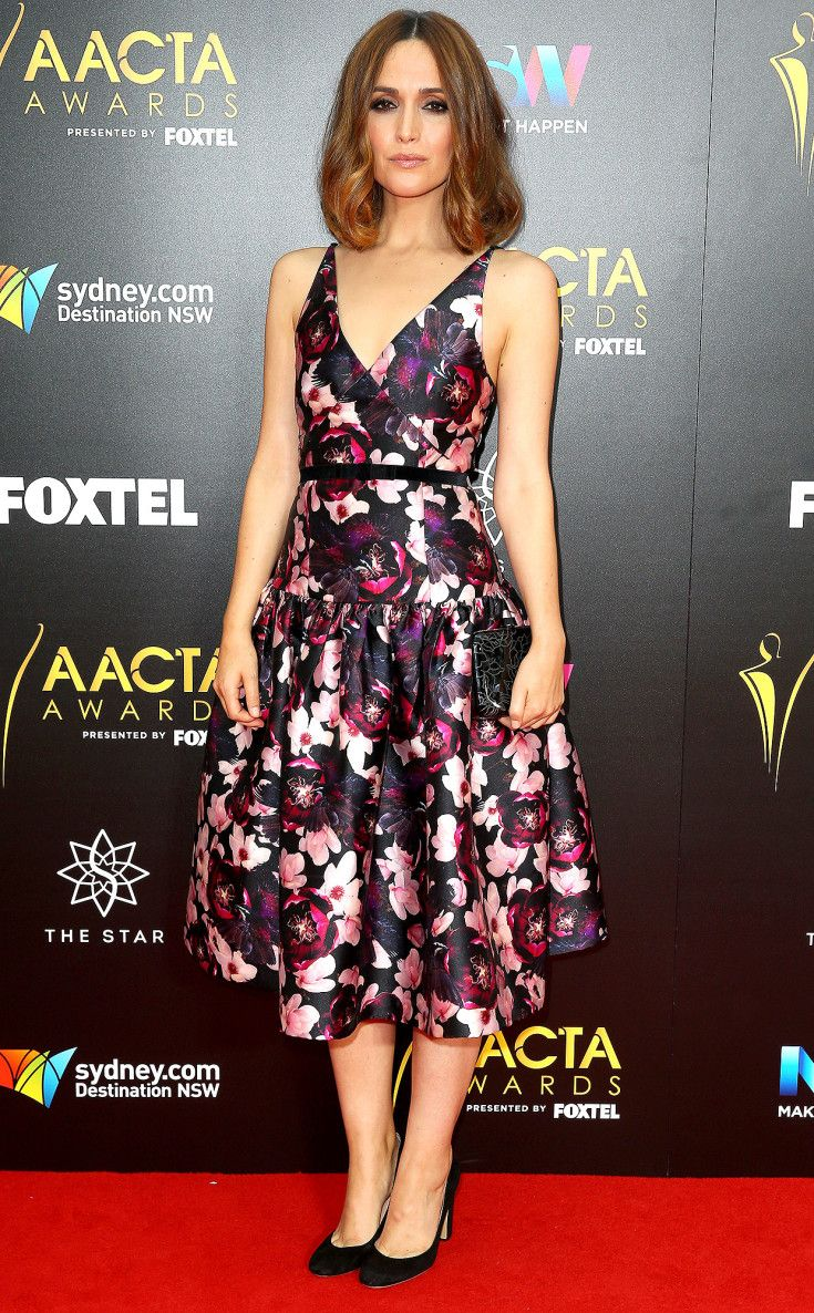 ROSE BYRNE in a floral print, fit-and-flare gown and black heels for the 6th AACTA Awards in Sydney, Australia.