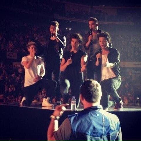 One Direction singing to their bodyguard Paul Higgins