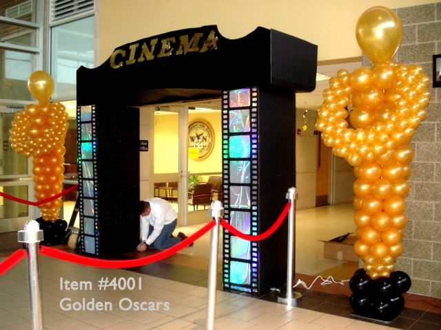 oscar theme balloon columns | Multiple shaped balloons to form the shape of the Oscar figurine ...