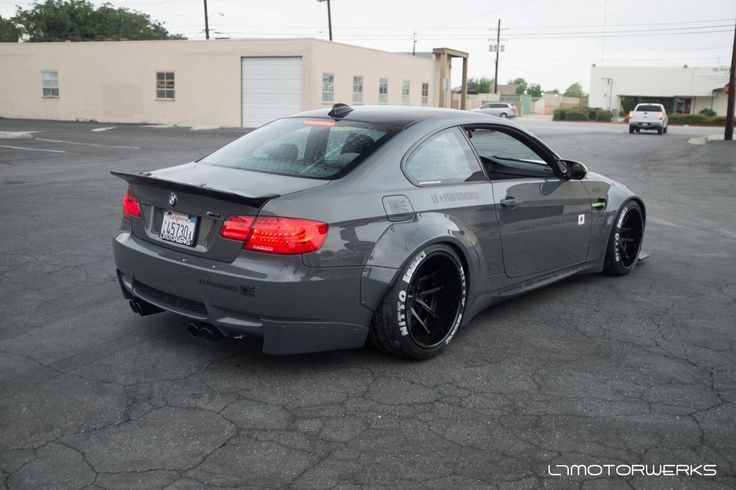 Widebody BMW M3 E92.  Looks full race, and even has dealer plates.  Love the dark gray color.