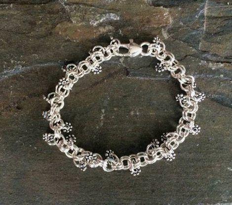 Here's some eye candy: http://etsy.me/1UkTZMg #SheilaBycraftJewellery #Bracelet #SterlingSilver #Flowers #Hearts