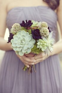 Bridesmaid bouquet with violet flowers and succulents