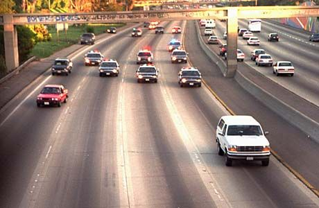 OJ Simpson's Ford Bronco being chased by police cars. The so very slow chase