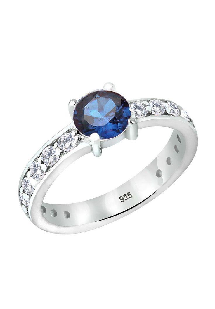 """Ein traumhaft eleganter 925er Sterlingsilber Ring mit einem synthetischen Saphir (6mm) und besetzt in Kanalfassung mit 18 weißen Zirkonia (2mm). In sehr hochwertiger Juweliersqualität gearbeitet. Der Ring ist hochglanzpoliert.  Weitere Hilfe zur Ringgröße:  Angegebene Größe in mm entspricht """"Ring Innen-Umfang"""", Umrechnung in """"Ring Durchmesser Ø"""" wie folgt:  52mm Umfang = 16,5mm Ø 54mm Umfang = ..."""