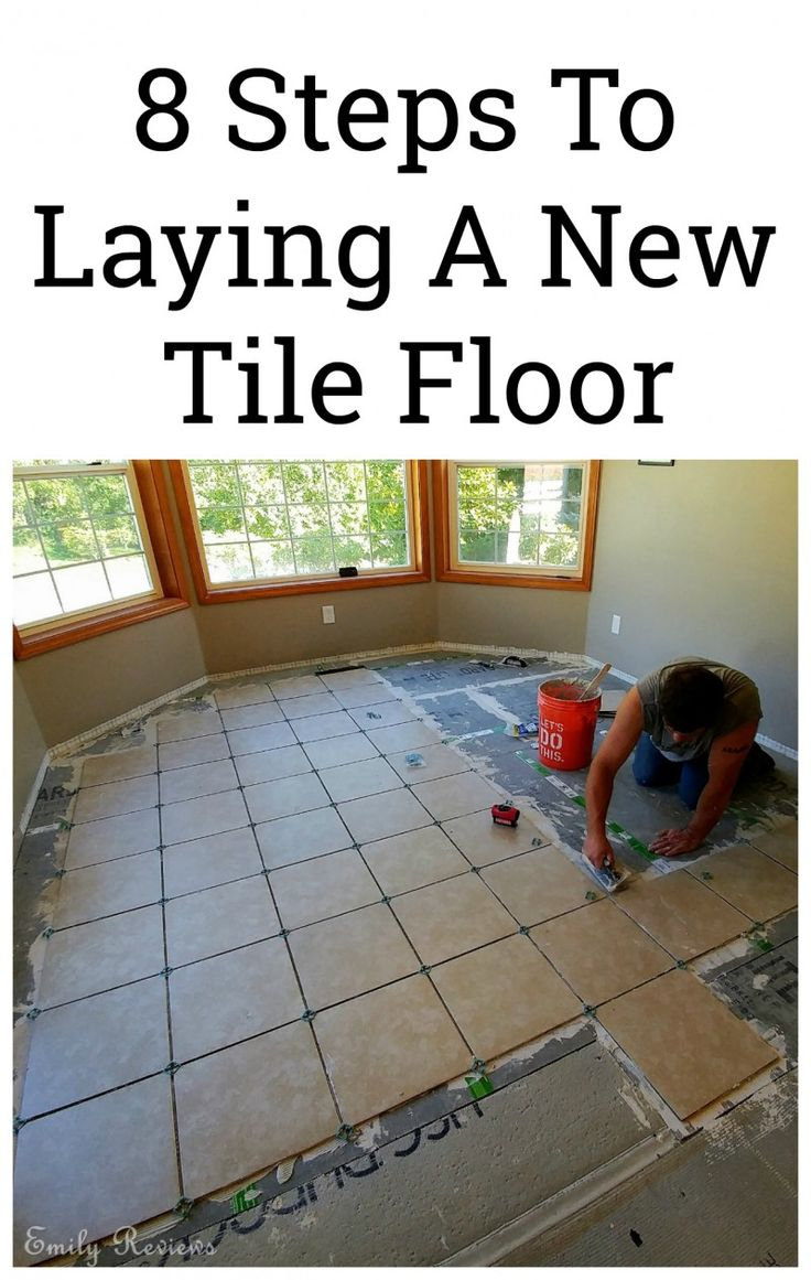 Laying your own tile floor isn't as difficult as you may think. 8 step tutorial for a DIY tile floor.