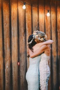 bride and best friend hugging
