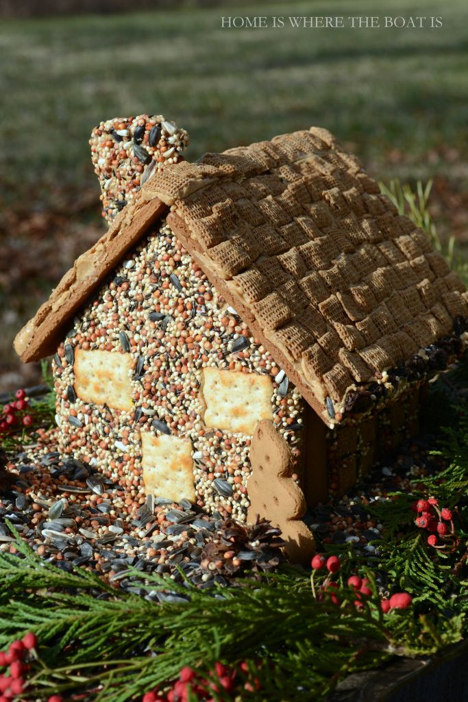 Gingerbread House Bird Feeder! Use a gingerbread house kit and decorate it for the birds with seed and cereal!  | Home is Where the Boat Is