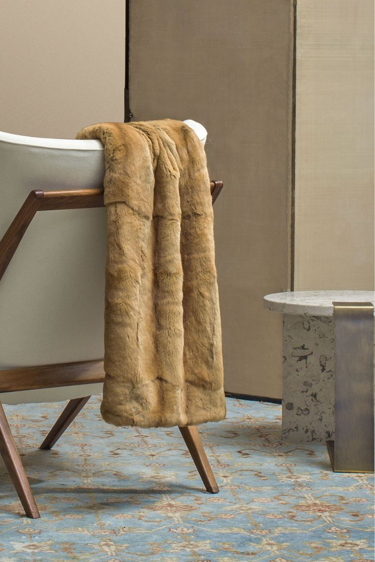 Cold outside, warm inside with the #Agnona cashmere and silk blanket with mink fur. #AgnonaFW16 #FW16 #Home