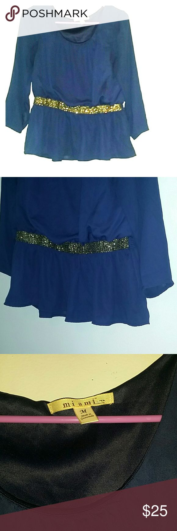 """Francesca's Miami Brand Navy Blue and Gold Blouse Miami brand from Francesca's  navy crepe chiffon tunic.  Size medium.  this is a lovely, lovely top.  Tunic with sequined waistband creating a bit of a blouson with a gathered bottom.   The upper part is lined in navy soft knit. Back waist is smocked elastic.  Bust 41"""" (meant to blouse) Length 23"""" Francesca's Collections Tops Blouses"""