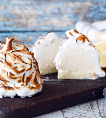 Mini Lemon Vanilla Baked Alaska-This quick and easy Lemon Vanilla Baked Alaska is an elegant, impressive frozen dessert that takes half the time of a traditional full-sized Baked Alaska. Made with pound cake and vanilla ice cream, this sweet treat is topped with a golden brown meringue. Individual sizes make this the perfect party recipe. We think they would be fun to serve at Easter or at a summertime get together.