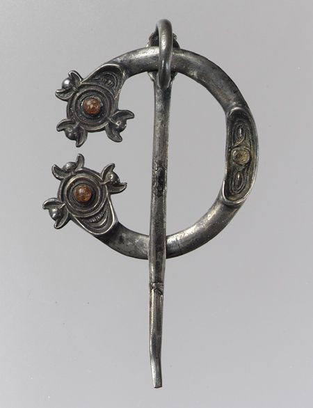 Open Ring Brooch, early 800s  Pictish or Irish; Found near Galway, Ireland  Silver with amber insets