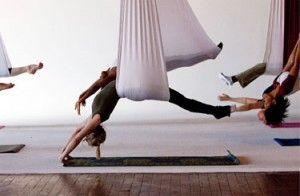 Aerial Yoga: Performed in silk hammocks. This looks like fun! #Yoga #Aerial_Yoga