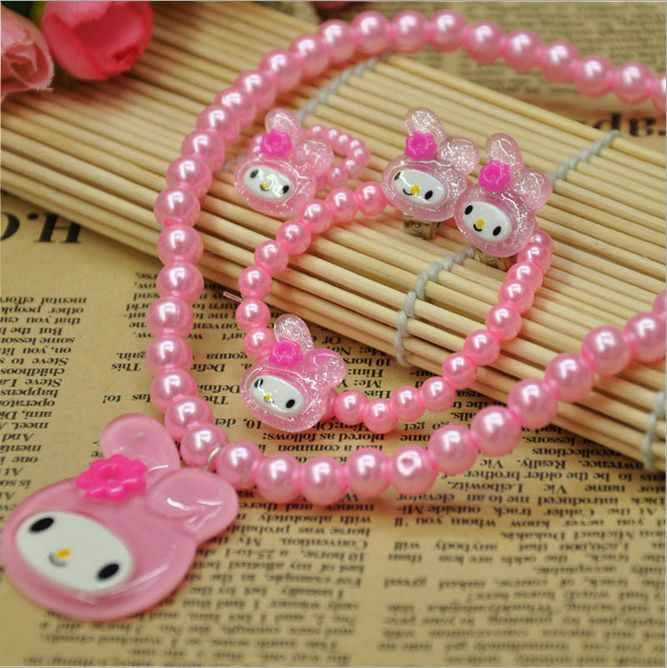 Shop online in India for pink pearl baby jewelry set consisting of teddy bear necklace, earrings, ring and bracelets makes up a wonderful combination to match up to your infants dress.