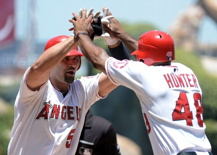 Game #86 7/8/12: Albert Pujols #5 of the Los Angeles Angels celebrates his two run homerun with Torii Hunter #48 for a 4-0 lead over the Baltimore Orioles during the third inning at Angel Stadium of Anaheim on July 8, 2012 in Anaheim, California. (Photo by Harry How/Getty Images)