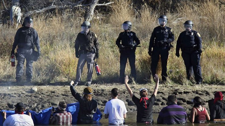 Non-violent resistance tactics used to stymie pipeline construction at Standing Rock last year could be in new legal jeopardy if lawmakers get their way.  CREDIT:   AP Photo/John L. Mone