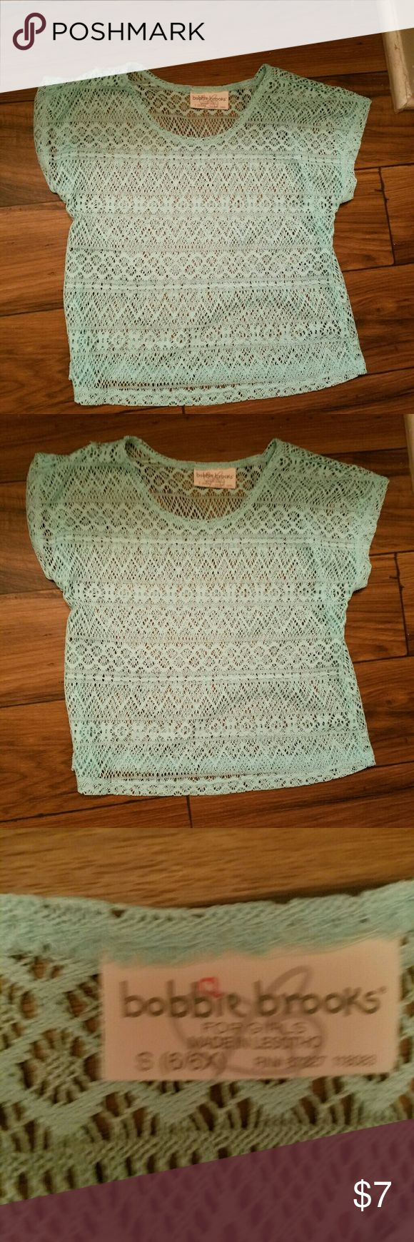 Cute mint colored Bobbie Brooks see through top Looks cute with a tank top underneath it. Bobbi Brooks Shirts & Tops Blouses