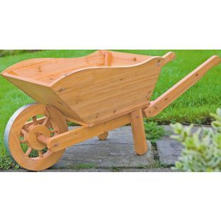 Wooden wheelbarrow planter argos woodworking projects for Landscape timber projects free plans