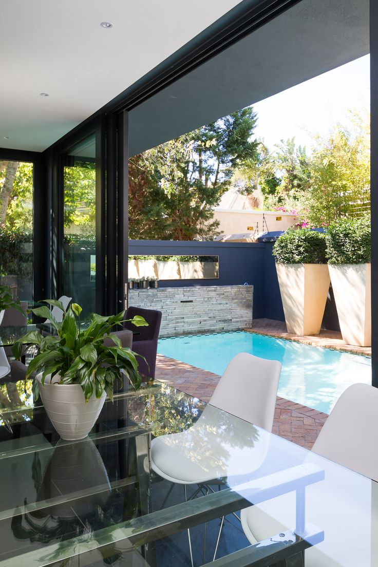 Breakfast room over view the sparkling pool. Contact: +27218866955 info@lifeandleisure.co.za www.lifeandleisure.co.za