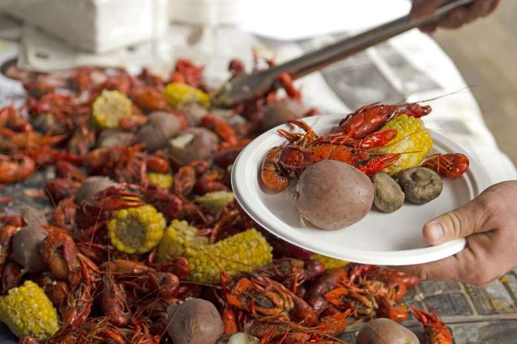 Visit New Orleans during crawfish season, December through May, to enjoy crawfish boils -- heaping m... - TFoxFoto/shutterstock