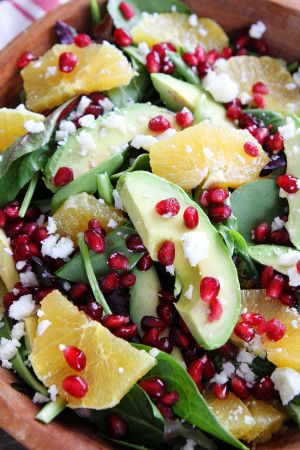 Pomegranate, Orange, and Avocado Salad Recipe on twopeasandtheirpod.com This simple salad is fresh, colorful, and so delicious! You have to try it!