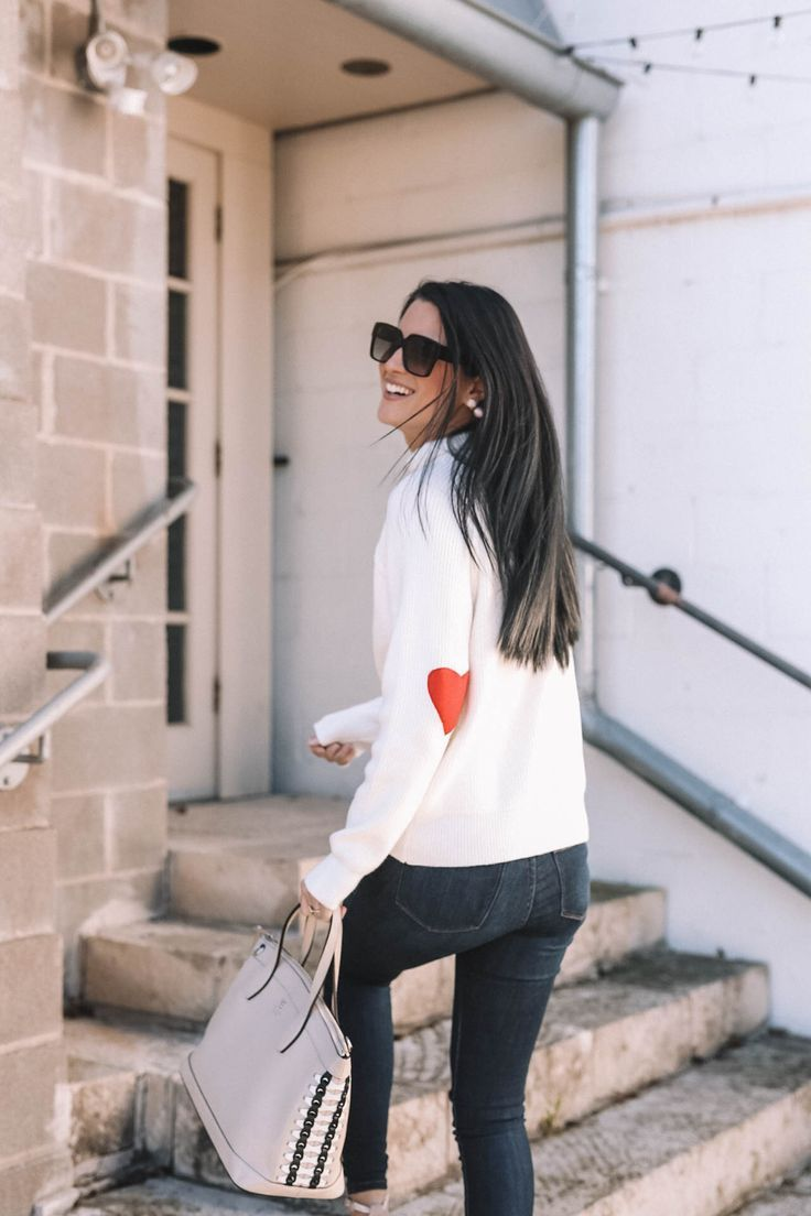 DTKAustin shares why she is dressing casual for Valentine's Day with this heart sleeve Chicwish turtleneck sweater. | Valentine's Day outfits | heart inspired outfits | Valentine's Day sweater | Valentine's Day outfit for women || Dressed to Kill #valentineoutfit #vdayoutfit #valentinesweater