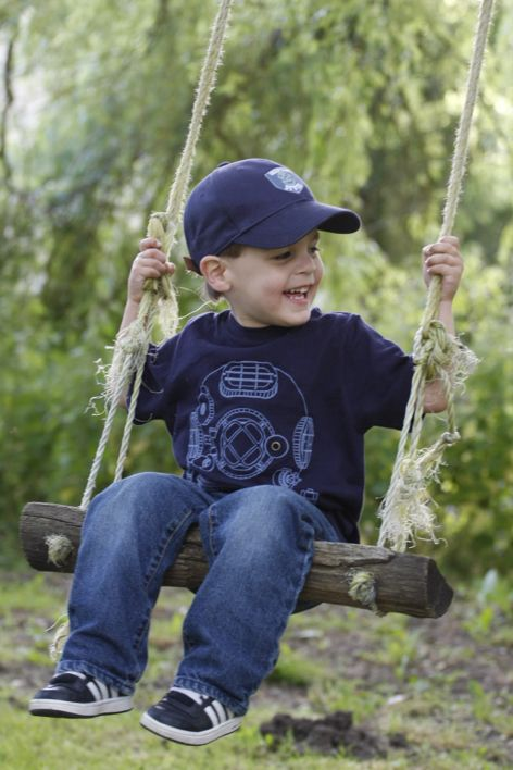 Kidder boy smiling and having fun on the swing - So cute