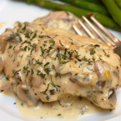 Julia Child's Chicken Breasts with Mushrooms and White Wine Cream Sauce ~ WARNING: If you make this dish, you may be tempted to lick the remaining sauce from the pan! The mushroom and cream sauce that smothers the chicken breasts in this recipe is so divine!