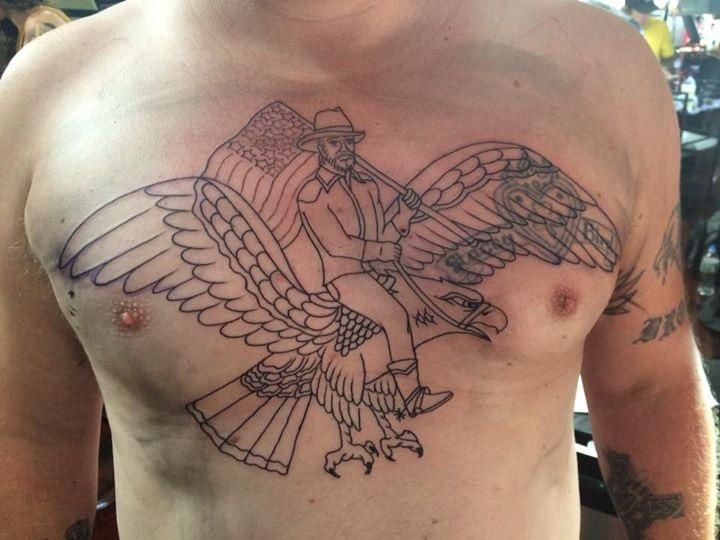 A terrible tattoo in the making. Chuck Norris riding an eagle holding an American flag. http://ift.tt/2ct937M