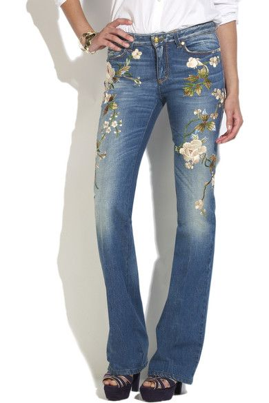 Mid-blue denim bootleg jeans with all-over multicolored floral embroidery. Roberto Cavalli jeans have a pocket on each hip, gold-tone designer-embossed rivets throughout, two patch pockets at the back, designer initials embroidered at back, contrast orange stitching throughout, intentionally faded patches, a gold-tone button and zip fly to fasten at front and belt loops. 99% cotton, 1% elastane; fabric2: 100% cotton; lining: 100% viscose. Machine wash inside out to avoid color transfer.