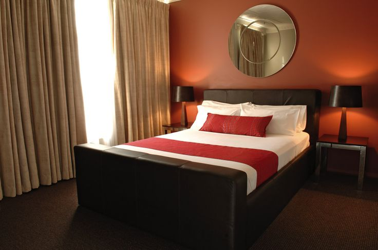 Love red bedrooms!  This would work with our current duvet cover and furniture, just need paint, coverlet and curtains.