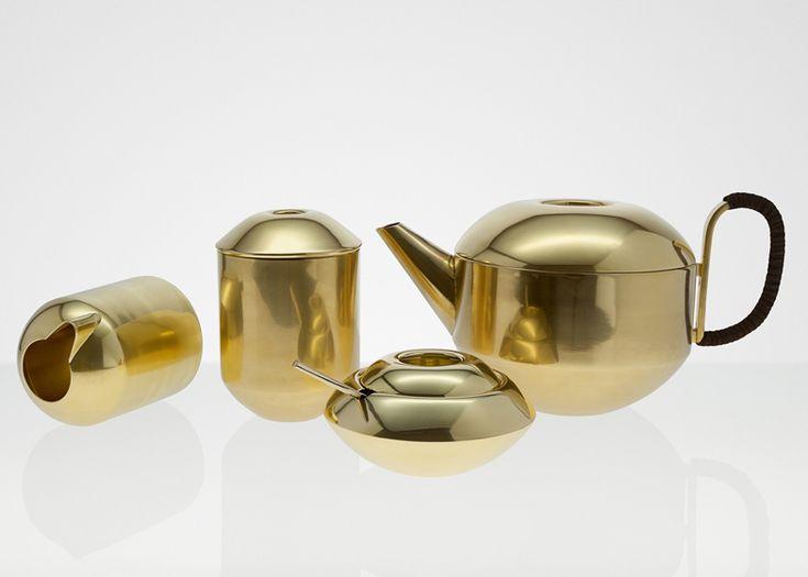 A tea set made of spun brass by Tom Dixon