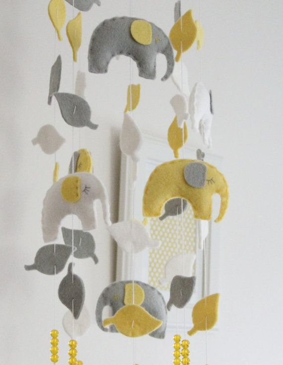 grey and yellow elephant mobile @Tabitha Isaacson what do you think about this one?