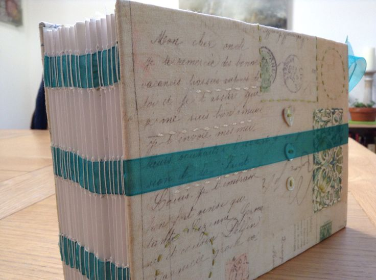 Stitched spine book over organza ribbons